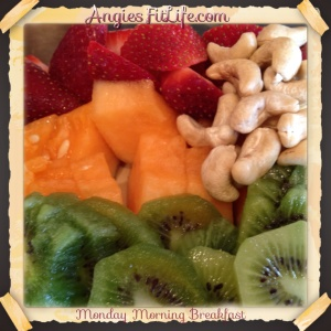 1/4 Cantaloupe, 6 Strawberries, 2 Kiwi's and 1 handful of cashews