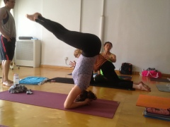 Rivka demonstrates a headstand from dolphin