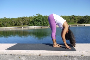 Uttanasana: Exhale. Once again, you may gently bend the knees in order to keep you back straight and rest your heart to your thigs